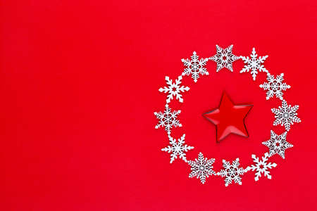 White snow flakes wreath decorations on red