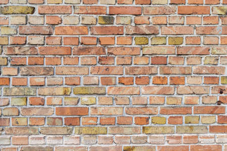 Old brick wall in a background image.