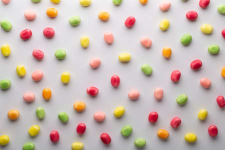 Small round candy-colored pastels on pastel background.