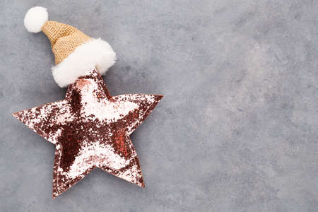 Christmas star, decor on pastel colored background. Christmas or New Year minimal concept. Stockfoto