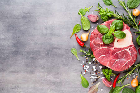 Raw fresh beef meat ribeye steak with spice and ingredients. Stockfoto