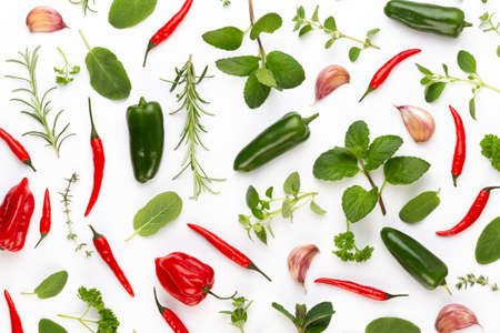 Spice herbal leaves and chili pepper on white background. Vegetables pattern. Floral and vegetables on white background. Top view, flat lay.