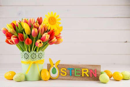 A colorful spring greetings card with flowers for Easter, Mother's Day.