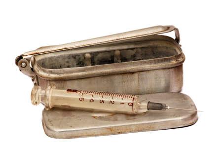 hypodermic syringe: old military syringe in its metal case