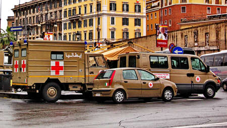 beatification: Rome, Italy - May 1, 2011 - Red cross military vehicles on the street in occasion of the beatification of John Paul II
