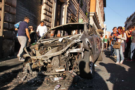 indignados: Rome - October 15 2011 - Car destroyed during the demonstration against the austerity measures