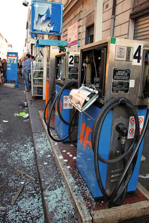 indignados: Rome - October 15 2011 - Petrol station destroyed during the demonstration against the austerity measures