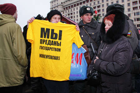 criticising: Moscow - December 4, 2011 - Parliamentary elections in Russia: woman protesting against unfair elections