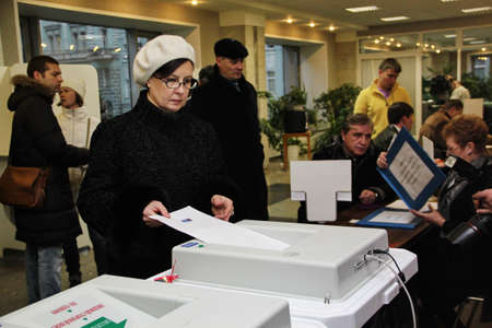 parliamentary: Moscow - December 4, 2011 - Parliamentary elections in Russia: woman voting