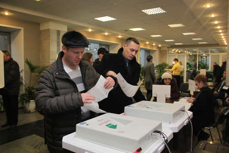 political system: Moscow - December 4, 2011 - Parliamentary elections in Russia: people voting