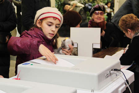 criticising: Moscow - December 4, 2011 - Parliamentary elections in Russia: little girl voting Editorial