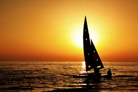 sail silhouette on the sunset photo