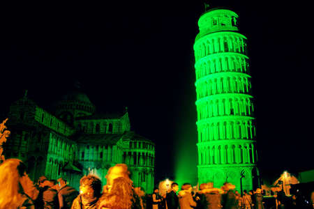 Pisa, Italy - march 16, 2012 - The leaning tower of Pisa is coloured with green lights in occasion of the saint patrick's day in sign of friendship betweet italy and the republic of ireland. Stock Photo - 12689938