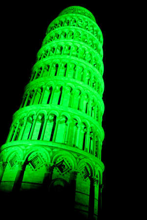 Pisa, Italy - march 16, 2012 - The leaning tower of Pisa is coloured with green lights in occasion of the saint patricks day in sign of friendship betweet italy and the republic of ireland.