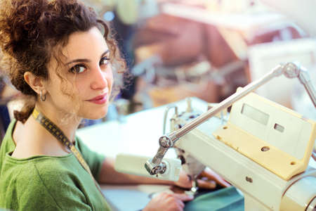 dressmaker: Portrait of a young dressmaker Stock Photo