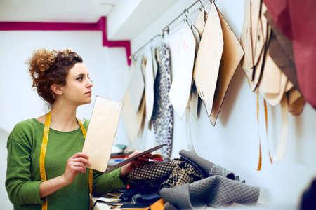 dressmaker: Dressmaker working her study