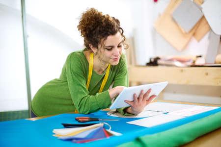 dressmaker: Dressmaker working with tablet