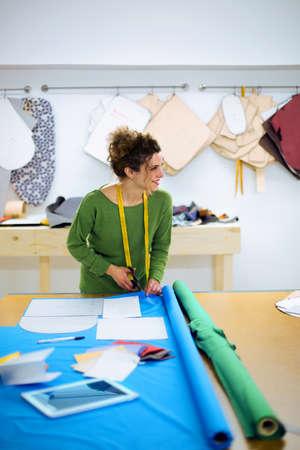 dressmaker: Dressmaker cutting the tissue