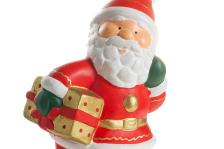 statuette of Santa Claus with a gift photo