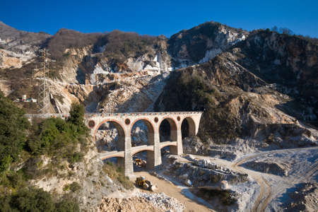 massa: Landscape of Carraras marble quarry (Italy) with the bridge in the locality Ponti di Vara.