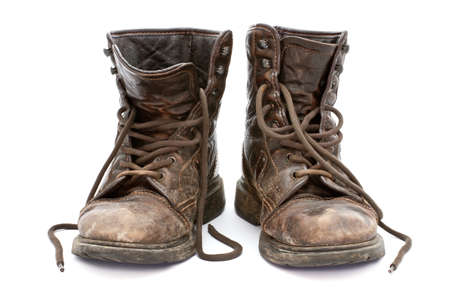 military boots: Dirty old boots isolated over white background