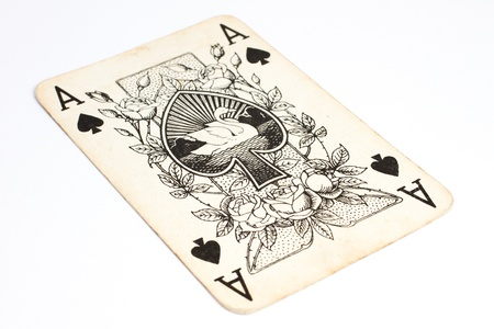 Ace of spades playing cards on a white surface