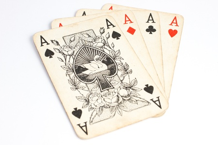 4 of a kind: Four aces of old playing cards on white surface
