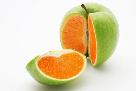 Photo manipulation:  green apple with orange content Stock Photo - 11594927