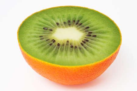 manipulation: Photo manipulation:  kiwi surrounded by an orange peel Stock Photo