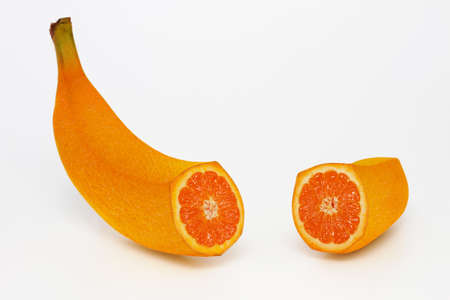 surrealistic: Orange shaped like banana on a white background Stock Photo