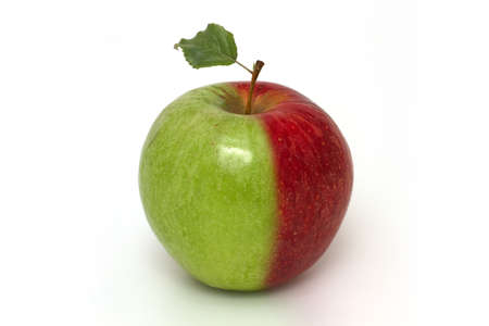 photo manipulation: Two-coloured apple  red and green  with leaf