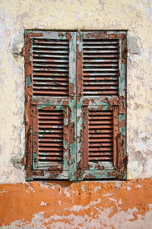 flaked: A very old weathered flaked off shutter
