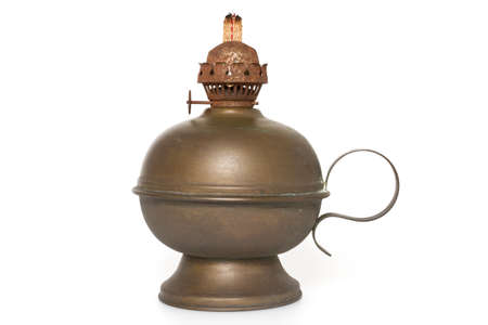 An old bronze oil lamp with wick isolated on a white background