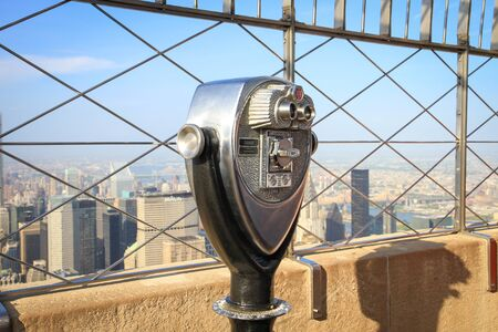 empire state: Binoculars on the Empire State Building observation deck in Manhattan, New York, USA