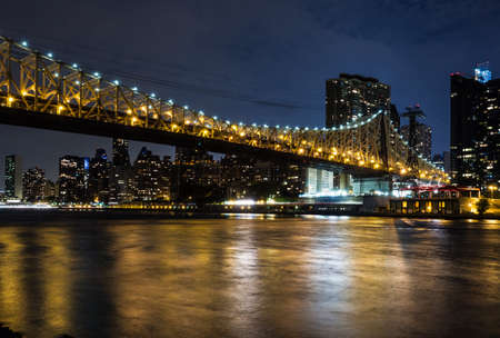 queensboro bridge: Queensboro Bridge, East River and Manhattan in the night as seen from Roosevelt Island in New York Stock Photo