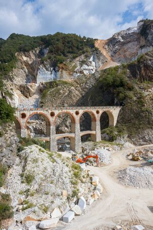 italy street: Landscape of Carraras marble quarry in Tuscany Italy with the distinctive bridge in the locality Ponti di Vara