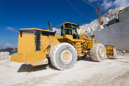 carrara: Excavator in a white marble quarry of Carrara, Tuscany, Italy