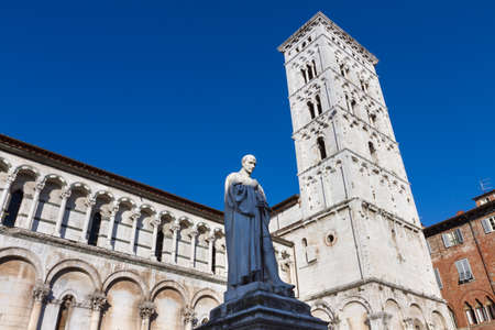 or san michele: Francesco Burlamacchis statue in Piazza San Michele near the church of San Michele in Foro in Lucca, Tuscany, Italy