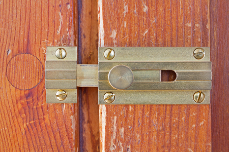 scraped: Close-up frontal shot of a latch on a wooden door Stock Photo