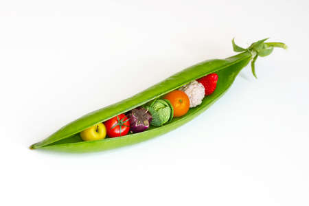 genetically modified organisms: A pea pod containing fruits and vegetables Stock Photo