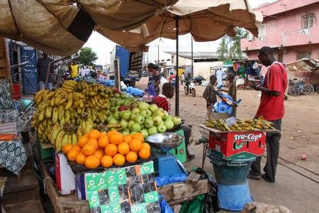 openair: Kaolack, Senegal - September 01, 2012: Little fruit stand in an open-air market in the street of Kaolack in Senegal.