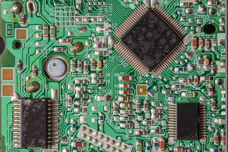 scraped: Close-up shot of an old and used integrated circuit board