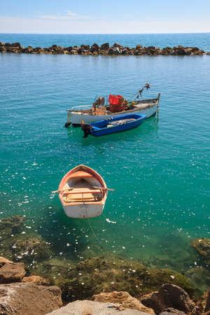 massa: Little fishing boats in the sea of Massa, Tuscany, Italy Stock Photo