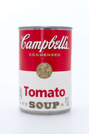 Massa, Italy - August 19, 2016: Campbells condensed tomato soup can on white background. The Campbell Soup Company, or Campbells, is an American producer of canned soups based in Camden, New Jersey. Andy Warhol used Campbells soup cans in pop art.