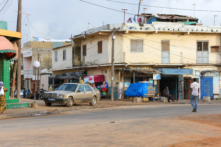 third world: Dakar, Senegal - September 09, 2012: People in  a district in the suburbs of the city of Dakar in Senegal