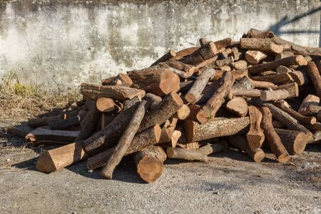 stack of firewood: Chopped firewood on a messy stack