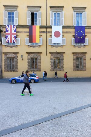 lucca: Lucca, Italy - April 09, 2017: The facade of the Ducal Palace in Lucca with the flags of the nations that take part at the G7 Foreign Affairs Ministers 2017 Editorial