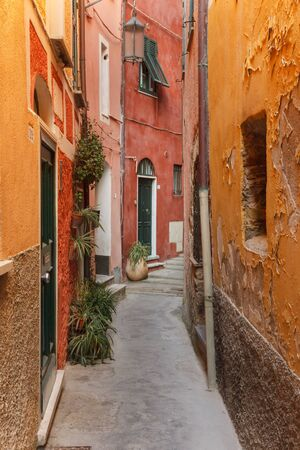 Path between old colored houses in Tellaro, a small fishing village in Italy. Stock Photo