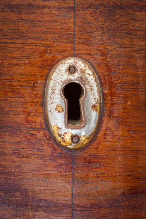 Close-up shot of an old scratched keyhole Stock Photo