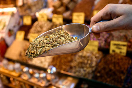 Man selling assorted natural medical dried herbs